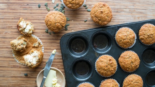 Orange, carrot, honey and pumpkin seed muffins